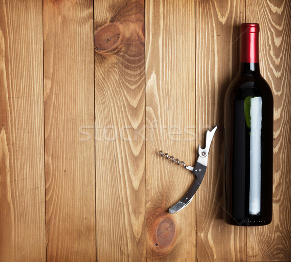 Red wine bottle and corkscrew Stock photo © karandaev