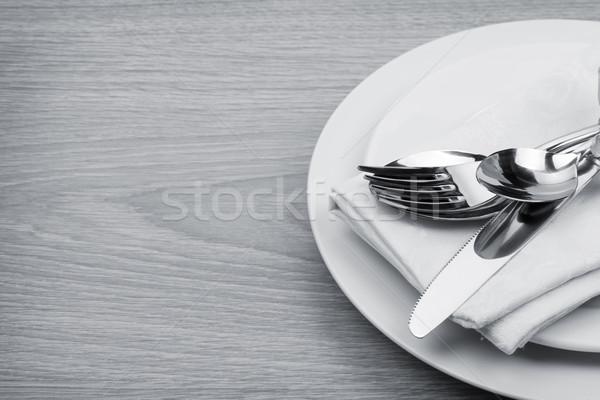 Silverware or flatware set of fork, spoons and knife on plate Stock photo © karandaev