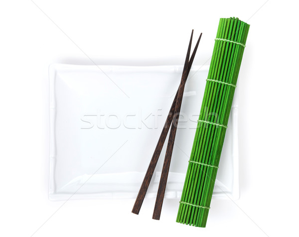 Empty plate, chopsticks and mat Stock photo © karandaev