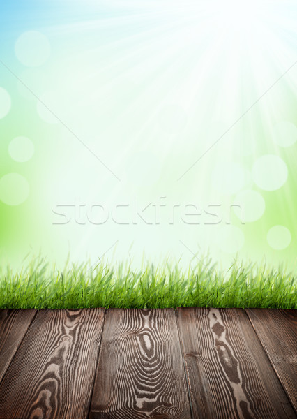 Summer background with wooden floor, green grass and bokeh Stock photo © karandaev