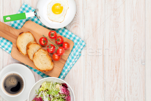 Stock photo: Healthy breakfast with fried egg, toasts and salad