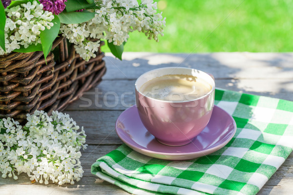 Stock photo: Coffee cup and colorful lilac flowers