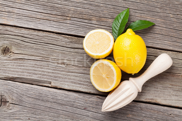 Fresh ripe lemons and juicer Stock photo © karandaev