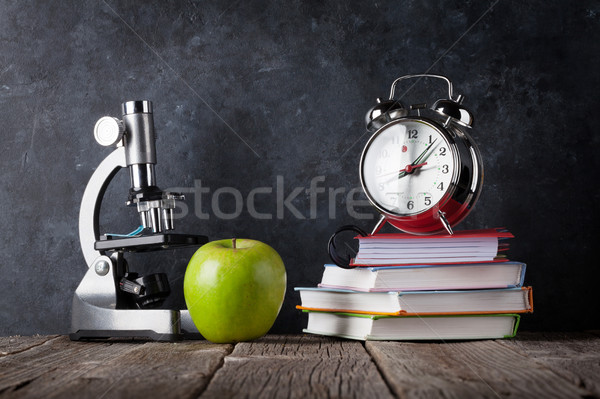 Microscópio despertador livros maçã sala de aula giz Foto stock © karandaev