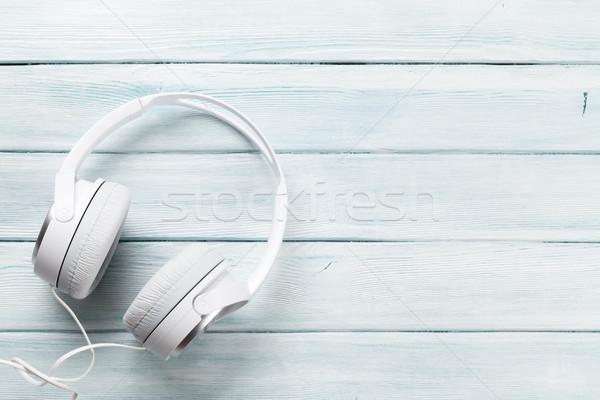 Beyaz kulaklık müzik ses ahşap masa üst Stok fotoğraf © karandaev