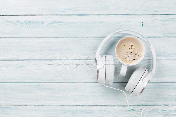 Headphones and coffee cup on wooden table Stock photo © karandaev