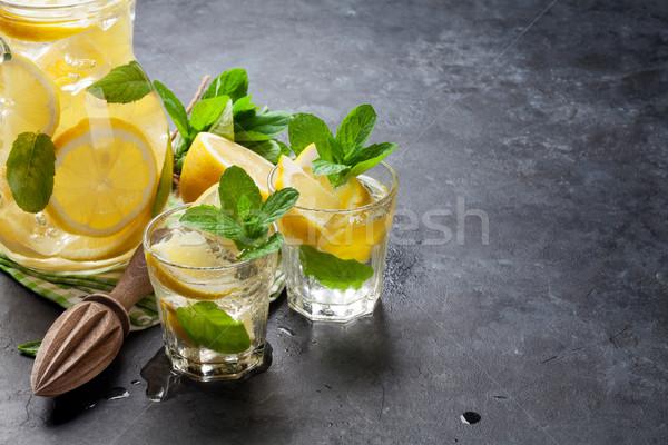 Stock photo: Lemonade with lemon, mint and ice
