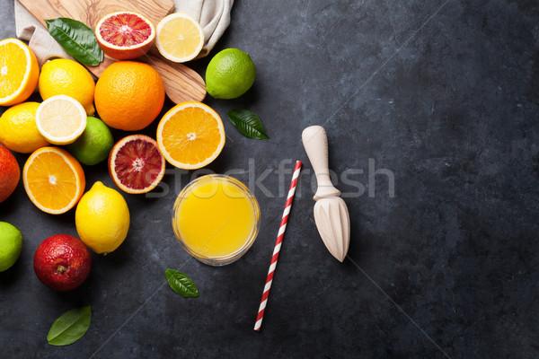 Fresh ripe citruses and juice. Lemons, limes and oranges Stock photo © karandaev
