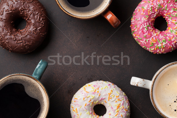 Coffee cups and colorful donuts Stock photo © karandaev