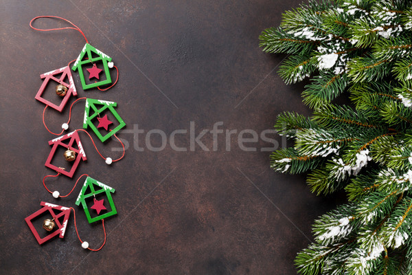Christmas background with snow fir tree and decor Stock photo © karandaev