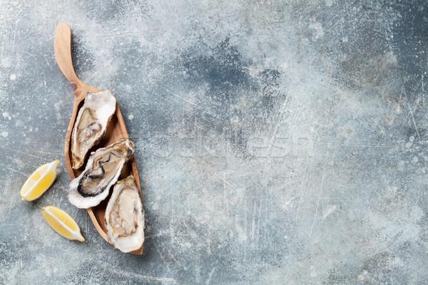Friss osztriga kő asztal felső kilátás Stock fotó © karandaev