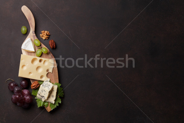 Cheese plate with grapes and nuts Stock photo © karandaev