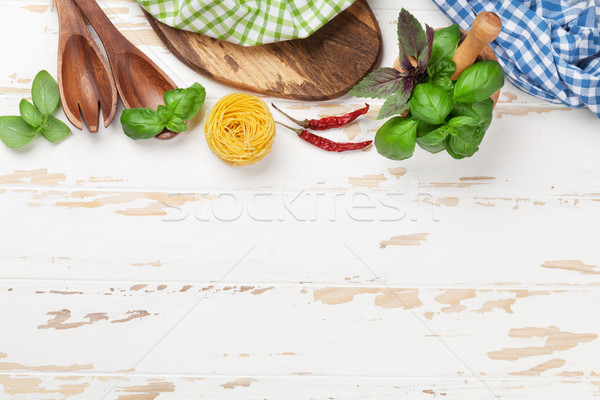 Cooking table with utensils and ingredients Stock photo © karandaev