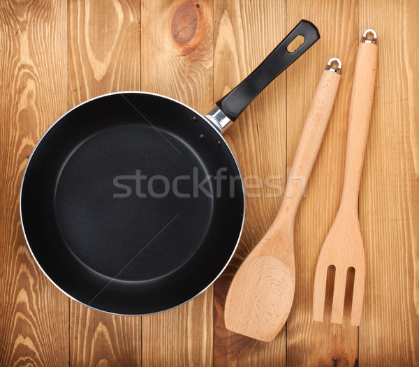 Serpenyő konyha kellékek fa asztal felülnézet háttér Stock fotó © karandaev