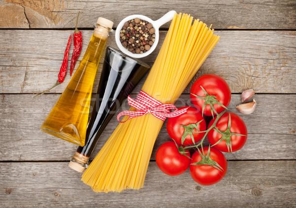 Tészta paradicsomok fűszerek fűszer fa asztal háttér Stock fotó © karandaev