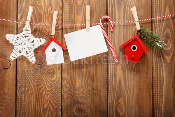 Snow fir tree, photo frame and christmas decor on rope Stock photo © karandaev