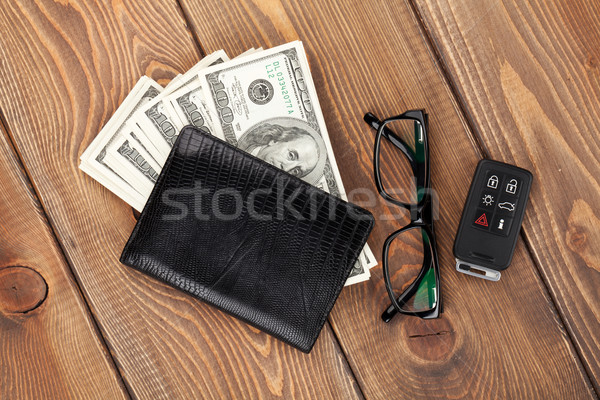 Money cash, glasses and car remote key Stock photo © karandaev