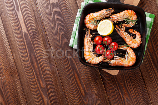 Grilled shrimps on frying pan Stock photo © karandaev