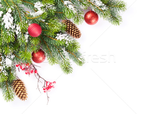 Christmas tree branch with snow and baubles Stock photo © karandaev