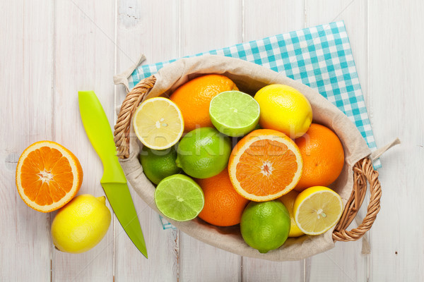 Сток-фото: цитрусовые · плодов · корзины · апельсинов · лимоны · белый
