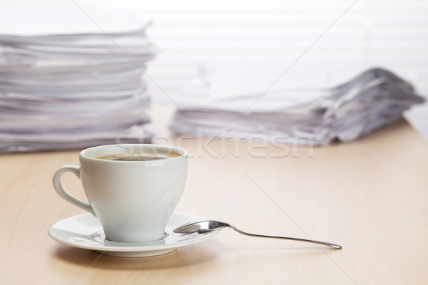 Office workplace with coffee and documents Stock photo © karandaev