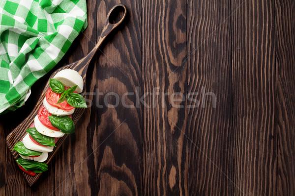 Mozzarella sajt paradicsom bazsalikom caprese caprese saláta Stock fotó © karandaev
