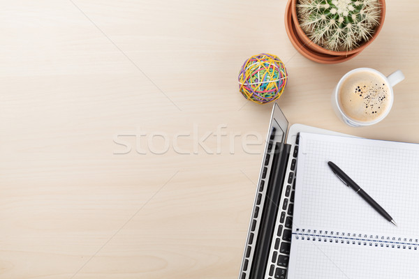 Irodai asztal laptop kávé kaktusz munkahely fából készült Stock fotó © karandaev