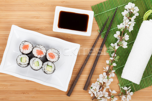 Sushi maki set with fresh sakura branch Stock photo © karandaev