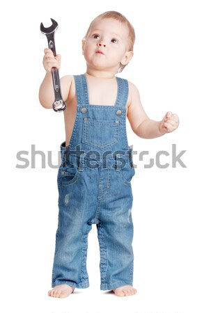 Small baby worker with spanner wrench Stock photo © karandaev