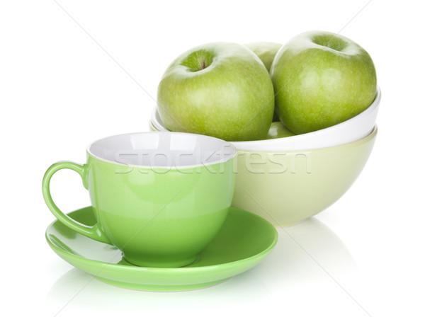 Zöld almák gyümölcsöstál teáscsésze izolált fehér Stock fotó © karandaev
