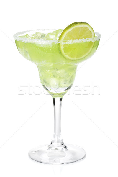 Classic margarita cocktail with lime slice and salty rim Stock photo © karandaev