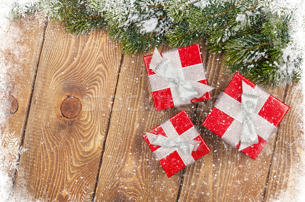 Old wood texture with snow, gift boxes and firtree Stock photo © karandaev