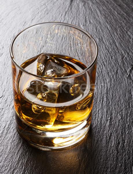 Glass of scotch whiskey with ice Stock photo © karandaev