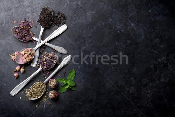 Válogatás száraz tea kanalak kő asztal Stock fotó © karandaev