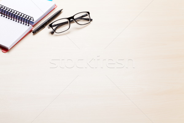 Office desk workplace with notepad and glasses Stock photo © karandaev
