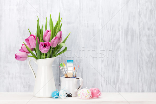 Easter eggs and pink tulips bouquet Stock photo © karandaev