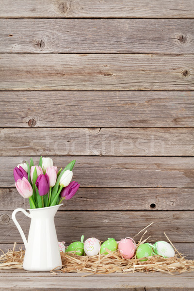 Easter eggs and colorful tulips bouquet Stock photo © karandaev