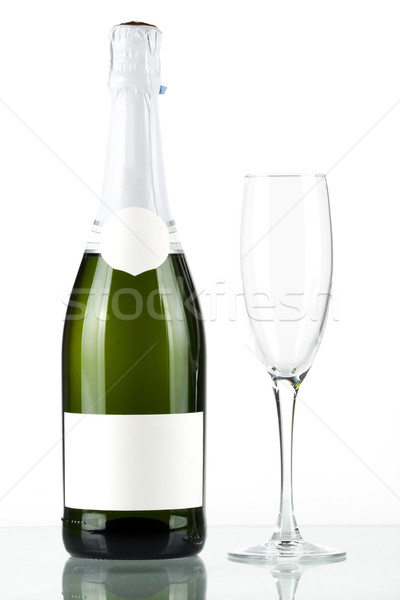 Bottle of champagne with blank label and with empty glass Stock photo © karandaev
