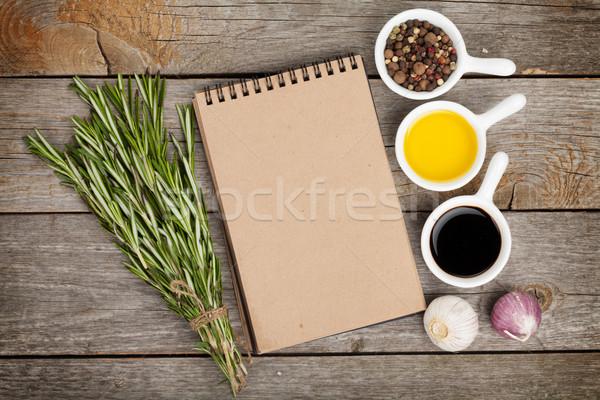 Olio d'oliva aceto spezie tavolo in legno notepad copia spazio Foto d'archivio © karandaev