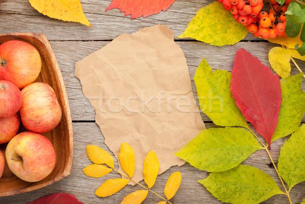 Autumn leaves, rowan berries and apples over wood background Stock photo © karandaev
