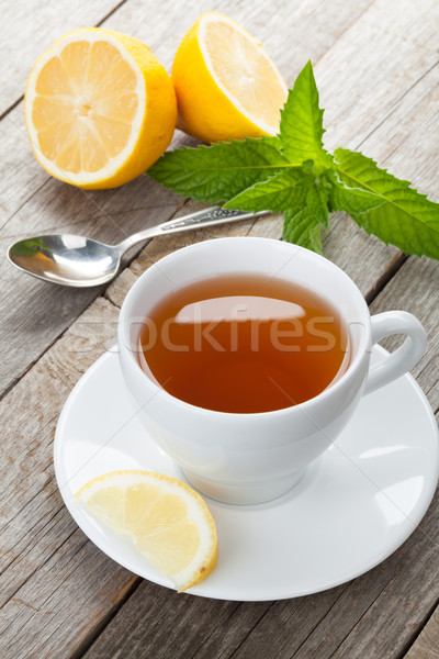 Green tea with lemon and mint on wooden table Stock photo © karandaev