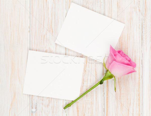 Blank photo frames and pink rose over wooden table Stock photo © karandaev