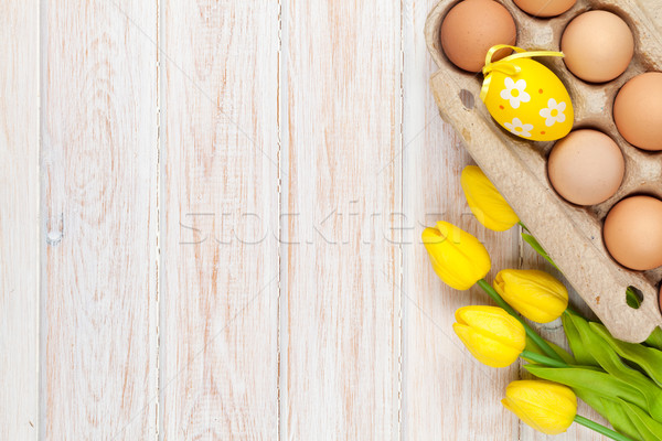 Easter background with yellow tulips and eggs Stock photo © karandaev