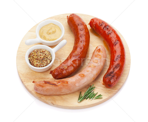 Various grilled sausages with condiments Stock photo © karandaev