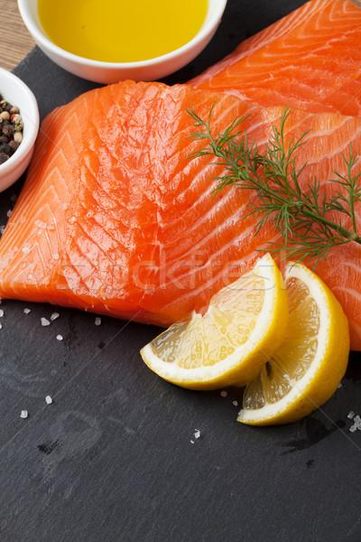 Salmon and spices on stone table Stock photo © karandaev