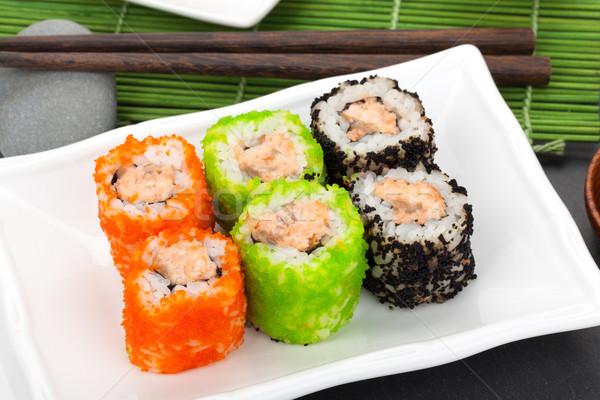 Colorido sushi maki bambu verde preto Foto stock © karandaev