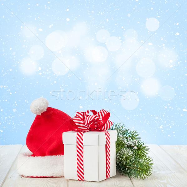 Christmas gift box, santa hat and tree branch Stock photo © karandaev