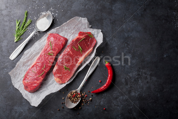 Raw striploin steak with rosemary Stock photo © karandaev