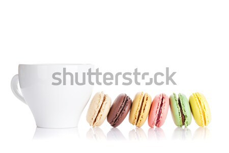 Colorful macaroons and cup of drink Stock photo © karandaev