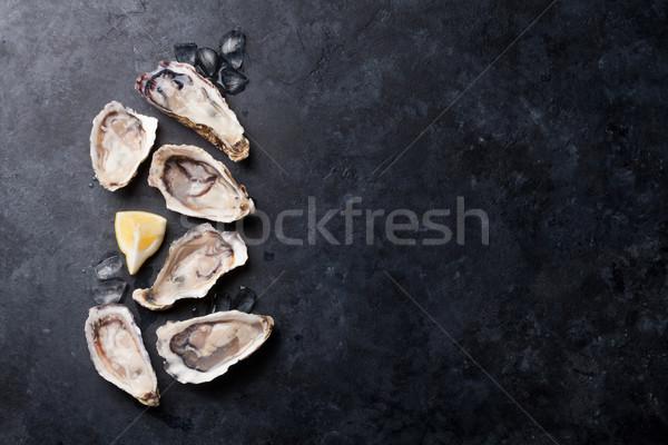 Istiridye limon buz taş tablo Stok fotoğraf © karandaev